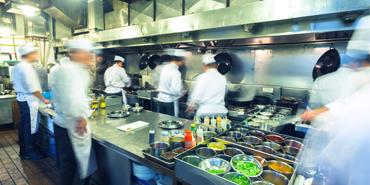 Chefs in busy kitchen