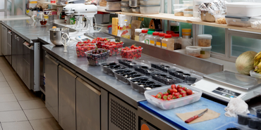Refrigeration equipment with ingredients on counter