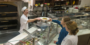Watertown Regional Medical Center - Man serving food on cafeteria line